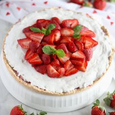This tart is loaded with fresh strawberries and thick coconut cream, all nestled in a coconut cookie crust for a decadent dessert!