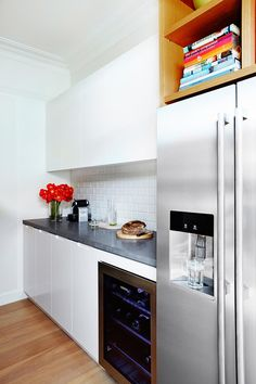 A butler's pantry tucked behind the kitchen keeps the fridge and other appliances out of view, and provides an extra workspace. Photo: John Paul Urizar