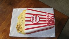 Buttercream popcorn: tips used for popcorn were 10,8,4. Once buttercream crusted, used tools to shape the popcorn and used airbrush paint to color in kernels and butter.