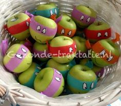 Ninja Turtle apples! I would use a fruit roll up for the mask, sugar eyes, and a food marker for the mouth.