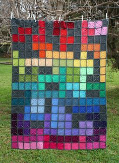 """Tetris Psychedelia"" #crochet blanket by Loretta Grayson, made as a tree cozy for the Jumpers & Jazz festival."