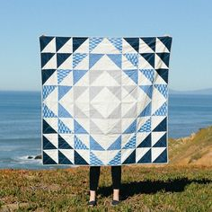 """- 60"""" x 60"""" - Katazome collection fabric, Kona cotton and Essex linen- Hand-quilted with cotton embroidery thread - Lightweight cotton batting- Made in CaliforniaMy current everyday is dominated by the Pacific, but the Atlantic Ocean was my first love. While not nearly as dramatic as the West Coast, I miss the sand dunes, the boardwalks, the gentle waves and the beach grass of the East Coast. The Atlantic Quilt is meant to be used as a cozy throw or hung as..."""
