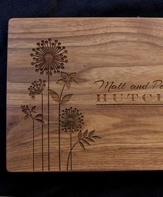 A Personalized Cutting Board with Flowers and Dandelions - Makes the Perfect Gift