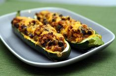 """I made with italian sausage and rice, yum! """"Stronger Together: Southwestern Stuffed Zucchini Boats"""" Zucchini Boat Recipes, Zucchini Boats, Veggie Recipes, Real Food Recipes, Vegetarian Recipes, Healthy Recipes, Stuffed Zucchini, Chicken Zucchini, Veggie Meals"""