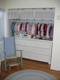 great idea to put the dresser in the closet, a space saver for a small room! and the valance hiding junk at the top is a smart and cute idea too!