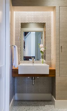 Expert Tips for Bathroom Design - In the powder room, warm teak and mossy grass cloth set the stage for a bold, black-and-white tile mosaic. (Photo: Michael Lee)