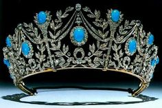 THE PERSIAN TURQUOISE TIARA Known as the Triumph of Love Tiara.Persian turquoise stands for love, and adorns a delicate diamond structure of gold and platinum of laurel wreaths for triumph, lovers' knots, and torches of love. The tiara is part of a parure including a necklace, earrings, and a brooch.c. 1900