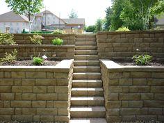 Retaining Wall In The Backyard With Stairs Side Yard Side Yard Landscaping, Landscaping Retaining Walls, Landscaping Ideas, Backyard Ideas, Hillside Garden, Garden Paths, Sloping Garden, Path Design, Garden Design
