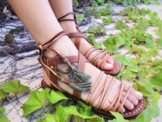 Willow Sandal // These safari sandals have a mix of strappy leather in tan and cognac & long leather ankle wraps with moss green tassels that can be tied in a variety of ways // $88 #shoplocal #freepeople #freepeopleboutique #shoes
