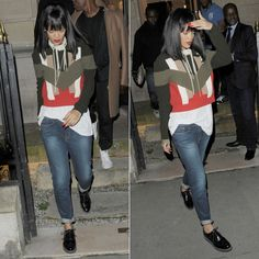 Rihanna wearing Givenchy sweater and Frame Denim boyfriend jeans.