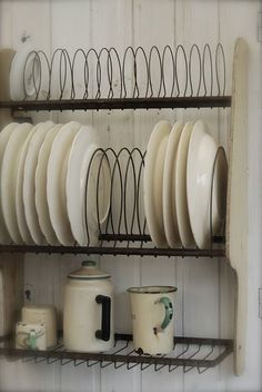Love the wire but would want a solid bottom shelf to stack and also hang cups from. Use to store the crockery used daily. 2-4 plates, bowls, cups. Mismatched and old.