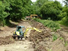 Reprofiling the canal just above Devils Hole lock.