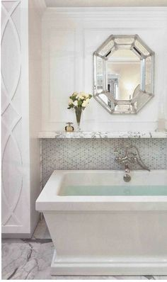 In The Master Bathroom, The Tailored Lines Of A Kallista Tub From Clyde  Hardware Co. And The Cool Demeanor Of Statuary Marble Surfaces Are Softened  By ...