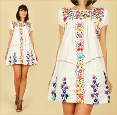 ViNtAgE 70's White Rainbow Floral Hand Embroidered Mexican MiNi Dress Tunic. $68.00, via Etsy. --- back to my roots <3