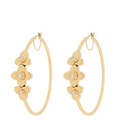 <p>The Pave Petal Medium Hoop earrings are this season's mod interpretation of the classic design silhouette. Crafted with finely plated…