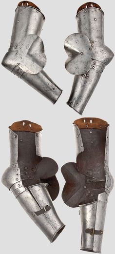 North Italian Gothic vambraces circa 1430-40.  For the right and the left arm and each very similar, each comprising an open upper-cannon with turned top and bottom edges, the left upper-cannon with two indistinct maker´s marks each involving a split cross, the two upper-cannons each articulated, Length 43.5 cm. and 44.5 cm. Weight (left) 1295 g. and (right) 1235 g.