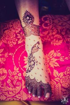 Real Indian Weddings - Sanam and Rohan | Beautiful Bridal Feet Peacock Mehendi Design #mehendi #design