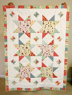 Scrappy Stars by Anjeanette (free pattern & tutorial) - I like the small squares between the larger stars - so cute!