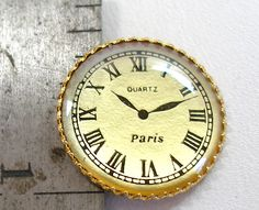 Realistic novelty Paris clock button.