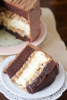 Chris' Outrageous Cheesecake Recipe -- a copycat of the popular Cheesecake Factory dessert with layers of chocolate cake, brownie, cheesecake and coconut caramel pecan frosting!