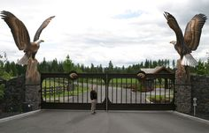"""Proposed """"Enduring Spirit"""" Eagle Monument by World Renown Chester Fields. Chester Fields specializes in eagle statues and monuments from - high Front Gates, Entrance Gates, Stone Driveway, Driveway Design, Metal Garden Gates, Modern Fence Design, Iron Gate Design, Farm Gate, Driveway Entrance"""