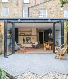opt for original patio bordering with an unfinished herringbone tile look. Exterior Design, House Extension Plans, Home, House Exterior, London Apartment Interior, House Inspiration, New Homes, House Extension Design, Patio Tiles