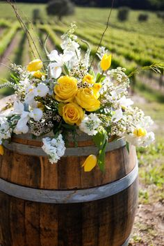 wine barrel with flowers this would be so cute on a porch for a flower bed