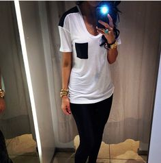 white t-shirt with black leather pocket and shoulders, black leggins