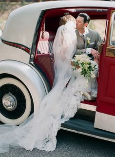 Love that veil. and the fact that they used this fun old car instead of a limo! so vintage