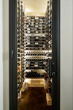 700 bottles of wine stored in floor-to-ceiling custom racks and temperature controlled walls. More from Pipkin Homes: