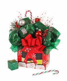 Wish someone a Merry Christmas and Happy Holidays with our Christmas Snowman Cookie Box Bouquet.  Our snowman box cookie bouquet contains 8, 10, 12 or 16 chocolate chip cookies on a stick and handmade bows and ribbons.