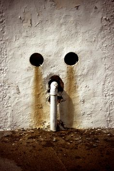Hena Tayeb Photograph of Urban Water Stained Wall and Water Pipe taken in Aruba