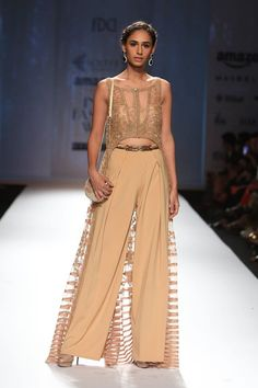Ashima Leena  Using colours of rust, brown and orange, this collection by Ashima Leena has a 70s style to it. From the prints to the fabrics...