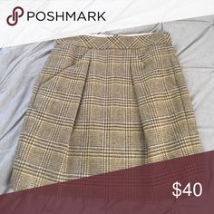 Plaid/houndstooth J. Crew high-waisted miniskirt This J. Crew high-waisted miniskirt features front pockets and a discrete zipper closure on the back. The pattern is plaid houndstooth. The skirt is fully lined so no need to worry about any undergarments showing! J. Crew Skirts Mini
