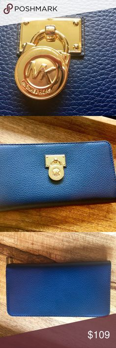 """NWT 🌷Michael Kors Hamilton Travel wallet The Micheal Kors traveler wallet is set in textured leather and features the MK logo imbedded in a gold padlock charm. 10  CC slot and 3 bill compartments. 1 zip pocket. Use it as a clutch too! I have it vanilla and navy. It measures about 8"""" x 4"""" x 1.25"""". This listings is for the blue one. Brand new never used. No bundle item. Michael Kors Bags Wallets"""