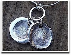 Thumb print charm necklace.  Perfect for new babies or to memorialize a loved one.
