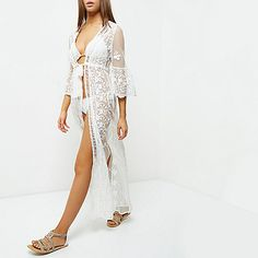 Sheer lace fabric Beach cover up Fluted sleeves Tie front detail Maxi length Open back