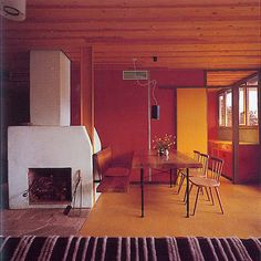 An interior by mid 20th century Italian modernist architect Edoardo Gellner.  Love the warm colors.