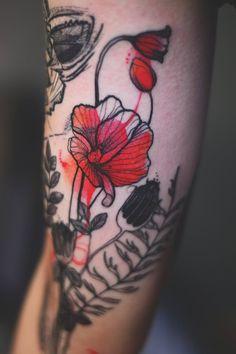 Joanna Swirska Dzo Lama flower tattoo