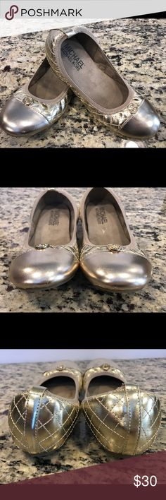 Girls Michael Kors ballet flats Girls Michael Kors ballet flats.  Gold with gold MK logo on tops.  Quilted design on sides and shiny gold at toes. Excellent condition!    Item #318 MICHAEL Michael Kors Shoes Dress Shoes