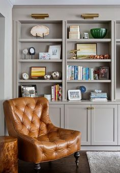 Leather tufted chair with gray styled built-ins | Daliance Design