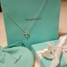 "🎉HP 7/16/16🎉NEW T & CO. CROSS /CHAIN SET 🎉🎉HOST PICK 7/16/16 SUMMER STAPLES PARTY🎉🎉 🚨PRICE FIRM🚨 NEW NEW NEW!!!! AUTHENTIC TIFFANY & CO. ELSA PERRETTI CROSS PENDANT AND CHAIN NEW IN BOX STERLING SILVER 16"" CHAIN 12MM X 9.5MM CROSS COMES WITH BOX & AND POUCH **MUST HAVE** NEVER WORN *NO TRADES PLEASE *NO RETURNS* *POSH TAKES 20% OF SALE* *FINAL SALE ASK QUESTIONS* Tiffany & Co. Jewelry Necklaces"