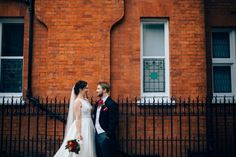 Couple portrait in front of red brick wall | Surrey wedding photographer | Faves of 2017