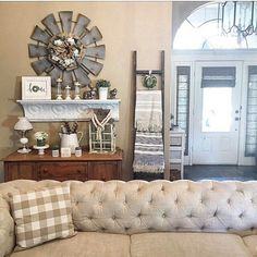 I Spy our #vintagestyle Windmill in Cindy's #homedecor Love your fantastic, bright entryway too. #home #walldecor