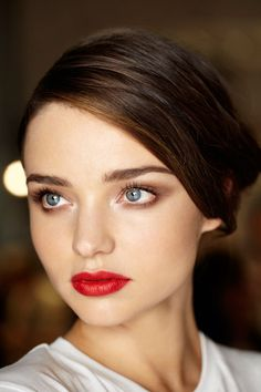 neutral eyes and red lips