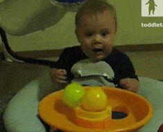Baby amazed at balls