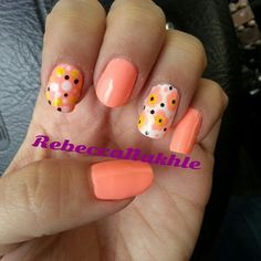 """It's raining like crazy out there but I'm all over spring and summer colors. Neon Coral Flower nails using China Glaze in """"Flip Flop Fantasy"""""""