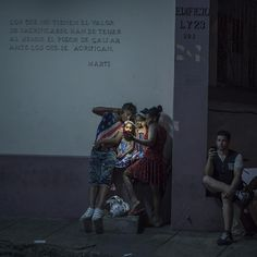 """cubans on the street, connecting via wifi with relatives overseas,  Michael Christopher Brown"