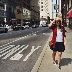 A red cardigan and a black skater skirt feel perfectly suited for weekend activities of all kinds. Grab a pair of gold slip-on sneakers for a more relaxed aesthetic.   Shop this look on Lookastic: https://lookastic.com/women/looks/cardigan-tank-skater-skirt-slip-on-sneakers-crossbody-bag-hat-sunglasses/12070   — Beige Straw Hat  — Red Sunglasses  — Red Cardigan  — White Eyelet Tank  — Black Skater Skirt  — Brown Crossbody Bag  — Gold Slip-on Sneakers