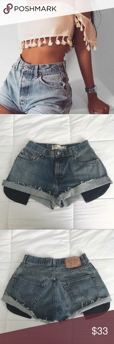 Cute grunge Levi's High Waisted Denim shorts Super cute denim levis shorts. Similar to brandy melville and john galt shorts. Vintage.  Perfect for summer! High waisted with a cuffed edge and a perfect gray blue wash. Cute black pockets peeking out. Very edgy and unique.  Waist measures as 27 inches Urban Outfitters Shorts Jean Shorts